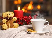 Cup Of Hot Drink With Steam And Teddy Bear, Cookie Berries Red Candle In Christmas Decoration On Coz poster