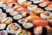 Overhead japanese sushi food. Maki ands rolls with tuna, salmon, shrimp, crab and avocado. Top view  poster