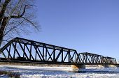 pic of trestle bridge  - Rail road trestle bridge spanning a river of ice - JPG