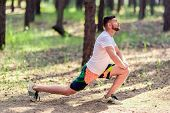 Athletic Man Runner Stretching Legs Before Run. Healthy, Fitness, Wellness Lifestyle. Sport, Cardio, poster