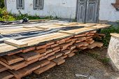 A Stack Of Pine Boards Soaked In An Antiseptic Solution Is Dried At The Construction Site. Building  poster