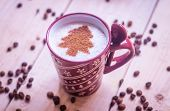 Cup Of Coffee With A New Year Pattern. Christmas Tree Made Of Cinnamon In A Cup With Coffee. Good Ne poster
