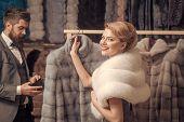 Fur Coat Fashion. Fur Coat On Sensual Woman With Bearded Man. poster