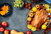 Thanksgiving Roasted Whole Goose On Rustic Table poster