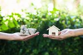 Home Loan, Lending, Mortgage, Transforming Assets Into Cash Concept : Hand Holding Home Model Change poster