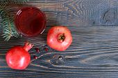 Ripe Pomegranate Fruit And A Glass Of Pomegranate Juice On Wooden Table. Healthy Eating Concept. The poster