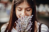 Beautiful Stylish Young Woman Holding Amazing Lavender Flowers And Smelling Them In Sunny Outdoors.  poster