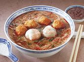 stock photo of wanton  - A bowl of curry noodles - JPG