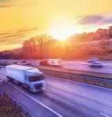 Heavy Truck Speeding On Highway At Sunset. Motion Blur. poster