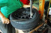stock photo of motor coach  - Car disc break detail with a worker - JPG