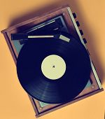 Vintage Vinyl Turntable With Vinyl Plate On A Yellow Pastel Background. Entertainment 70s. Listen To poster