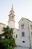 Old Church On The Background Of Palm Trees With A Tower And Bell Tower In The Old Town. poster