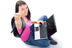 foto of teenage girl  - female sitting with her laptop in front of her - JPG