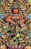 picture of lakshmi  - Colorful Wooden statue of Hindu goddess Lakshmi - JPG