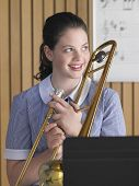 foto of trombone  - Portrait of a female student with trombone - JPG