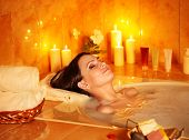 stock photo of bath tub  - Young woman take bubble  bath with candle - JPG