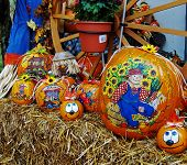 image of jack-o-laterns-jack-o-latern  - numerous pumpkins painted with a fall or halloween theme