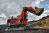 stock photo of dredge  - The big dredge digs the earth  - JPG