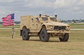 Soldier, Flag And Humvee At Eaa