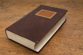 image of vintage antique book  - Closed Old Book on a Wooden Table - JPG
