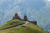 stock photo of trinity  - The Gergeti Trinity Church is the main cultural landmark of Kazbegi District  - JPG