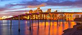 stock photo of florida-orange  - CIty of Miami Florida summer sunset panorama with colorful illuminated business and residential buildings and bridge on Biscayne Bay - JPG
