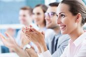 stock photo of applause  - Business team clapping in applause - JPG