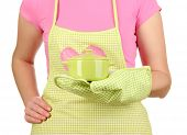 foto of homemaker  - Closeup of  homemaker in apron  holding  pan isolated on white - JPG