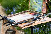 image of masterpiece  - Close up of a box easel with canvas - JPG