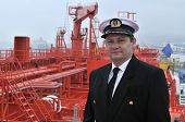 foto of lng  - Captain looking ahead on the navigation bridge of ocean ship - JPG