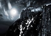 stock photo of moonlit  - moonlit night and clouds on night sky in the mountains - JPG