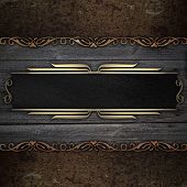 wooden background with rust metal plate and black nameplate