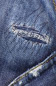 detail of a patch in blue jeans
