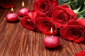 image of unity candle  - Romantic composition with red candles and roses. selective focus