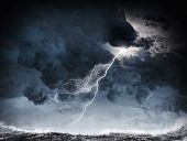 stock photo of lightning  - Image of dark night with lightning above stormy sea - JPG