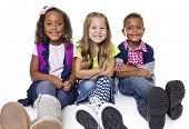 Diverse group of school kids isolated on white background. Smiling and happy children.