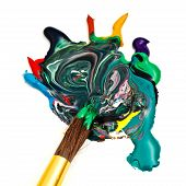 picture of merge  - round paintbrush merges multicolored watercolor paints close up - JPG
