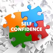 image of self-confident  - Self Confidence on Multicolor Puzzle on White Background - JPG