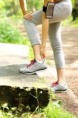 picture of ankle shoes  - A picture of a jogger having problems with ankle in the forest - JPG