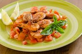 foto of crustaceans  - dish of cooked crustaceans dressed with tomato sauce - JPG