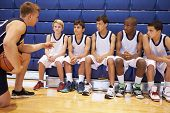 pic of motivation talk  - Male High School Basketball Team Having Team Talk With Coach - JPG
