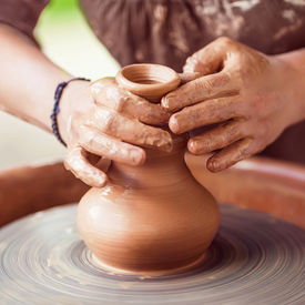 image of pottery  - Potter hands making in clay on pottery wheel - JPG