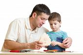 foto of nesting box  - Dad and son kid teach building nesting box isolated - JPG