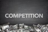stock photo of competition  - Competition word on black blackboard with hand - JPG