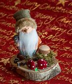picture of weihnacht  - a beautiful christmas candle Weihnachts  Wichtel auf Baumscheibe - JPG