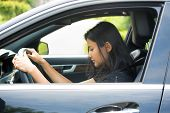 image of deprivation  - Closeup portrait tired young attractive woman with short attention span driving her car after long hours trip trying to stay awake at wheel isolated outside background - JPG