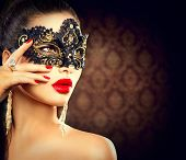 image of christmas party  - Beauty model woman wearing venetian masquerade carnival mask at party - JPG
