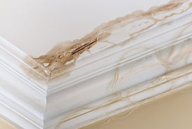 stock photo of leak  - Peeling paint on an interior ceiling a result of water damage caused by a leaking pipe dripping down from upstairs a result of substandard plumbing completed by an unqualified plumber - JPG