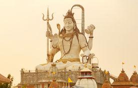 stock photo of shiva  - Shiva Statue at Sunset in Namchi - JPG