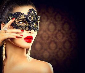 image of lip  - Beauty model woman wearing venetian masquerade carnival mask at party - JPG